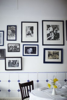 Family pictures adorn the walls inside La Famiglia